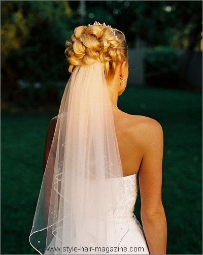 A Bundle Of Loopy Curls Sit At The Crown A Tiara Is Placed At The Front And A Mid L Wedding Hairstyles For Medium Hair Wedding Hairstyles Updo Wedding Hair Up