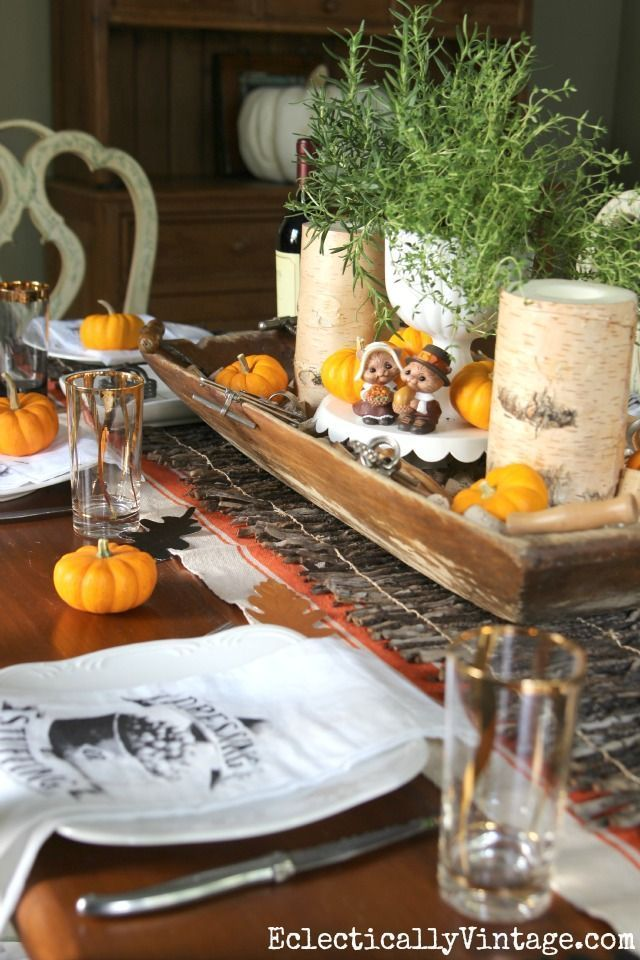 Thanksgiving Tablescapes - love this vintage dough bowl filled with corks, vintage corkscrews and mini orange pumpkins and the table runner from layered under the twig runner - plus see 25 more creative fall tables http://eclecticallyvintage.com