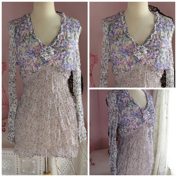 Pyramid Collection Purple Floral Peasant Top L In excellent shape! Absolutely gorgeous Pyramid Collection top is covered in purple, lavender, pink and green flowers! It is made of 100% sheer polyester that has plenty of give and stretch! The elasticized empire waist is accented with a fabric flower. The sleeves go into gentle bells and the v-neckline is accented with a small ruffle. Hand washable in cold water. Pyramid Collection Tops