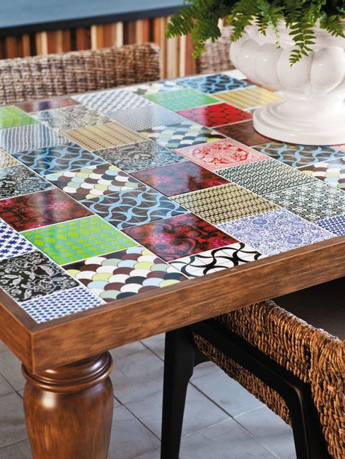 So Cool and Looks easy to clean.. I could definitely do this to an old table! Would be cool for an outdoor table.!