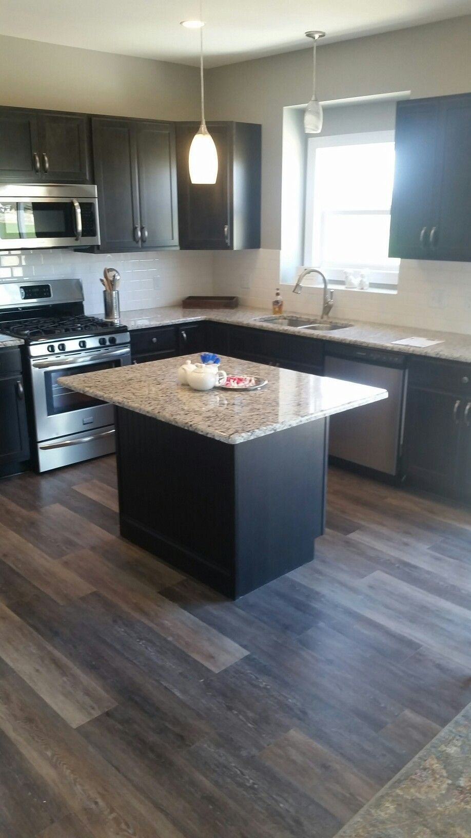 Granite Countertops And Island With Overhang Coretec Alabaster Oak Flooring Stainless Kitchen Cabinets Home Depot Vinyl Flooring Kitchen Oak Kitchen Cabinets