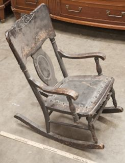 VINTAGE CHILDS VICTORIAN ROCKING CHAIR MADE OF WOOD WITH A PADDED LEATHER  SEAT AND METAL RIVETS