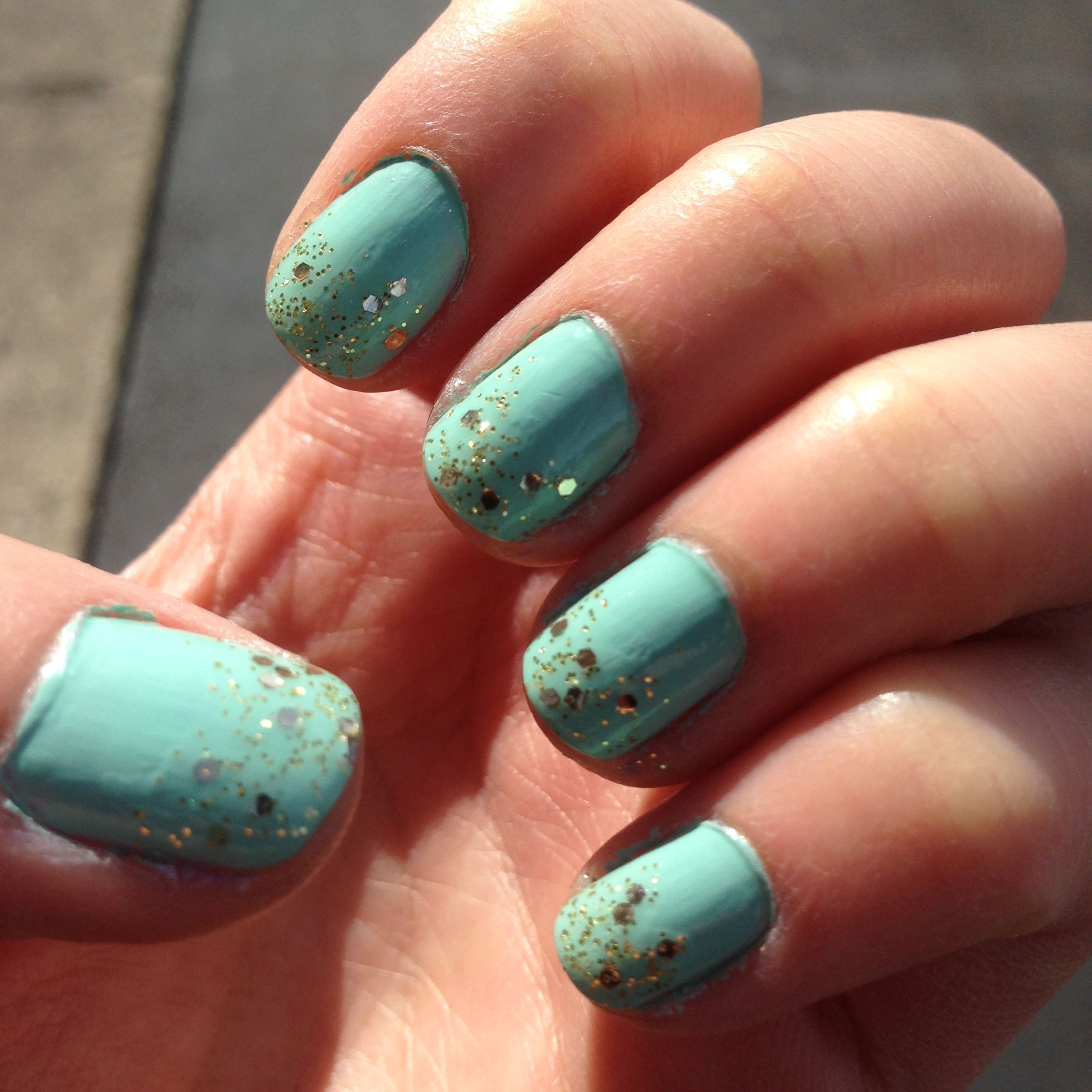 Light Turquoise Nail Art With A Gold Glitter Dusting Ombre