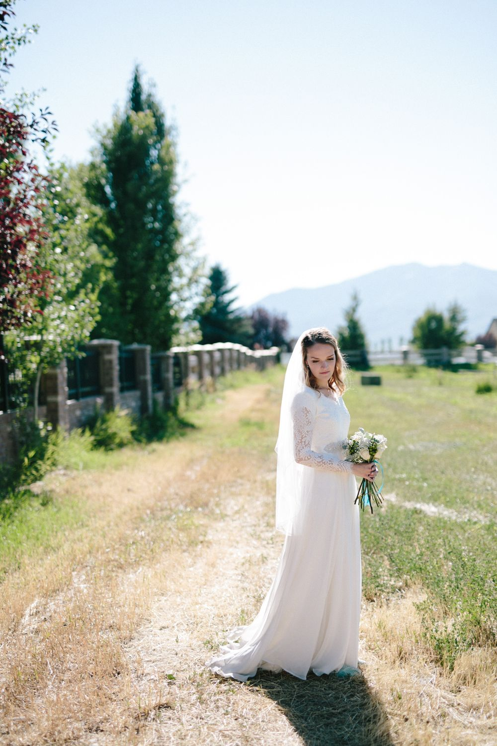 modest wedding dress with long sleeves from alta moda.