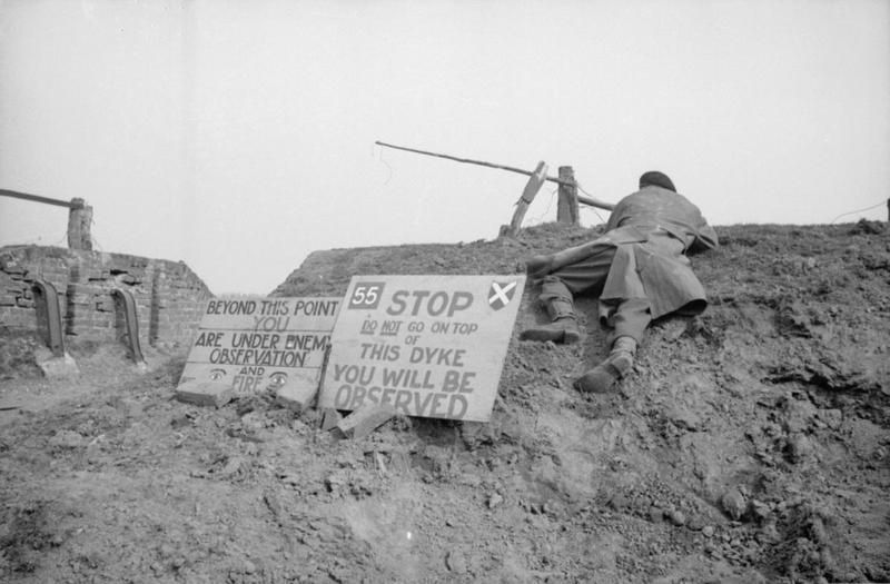 Signs warning of the dangers of enemy observation on the west bank of the Rhine (February 1945)