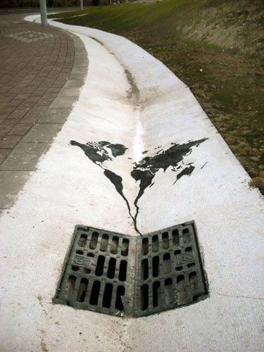 Painted world map heading down the drain art pinterest street the world going down the drain street art by pejak in santander spain powerful gumiabroncs Image collections