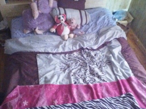 So on my bed i have a sheet a starry blanket my big blanket my pink blanket my dad got me when i was 5 months my zebra print blanket 1 regular pillow pet unicorn 1 mini pillow pet unicorn a fat pink bear named Arnold my pink bear that I've had the day before i was born my dad my grandmas and my papas got it for me, 1 brown and blue rectangle pillow and on blue and brown can shape throw pillow i think I'll be a little cozy tonight
