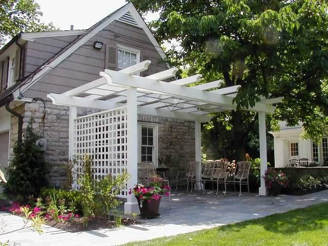 This Cedar Pergola Painted White Makes This House Look Like An English Cottage Small Backyard Landscaping Outdoor Pergola Backyard Pergola