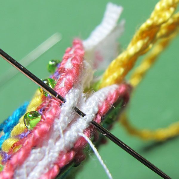 Assembling an embroidered scissor fob with a needle 13