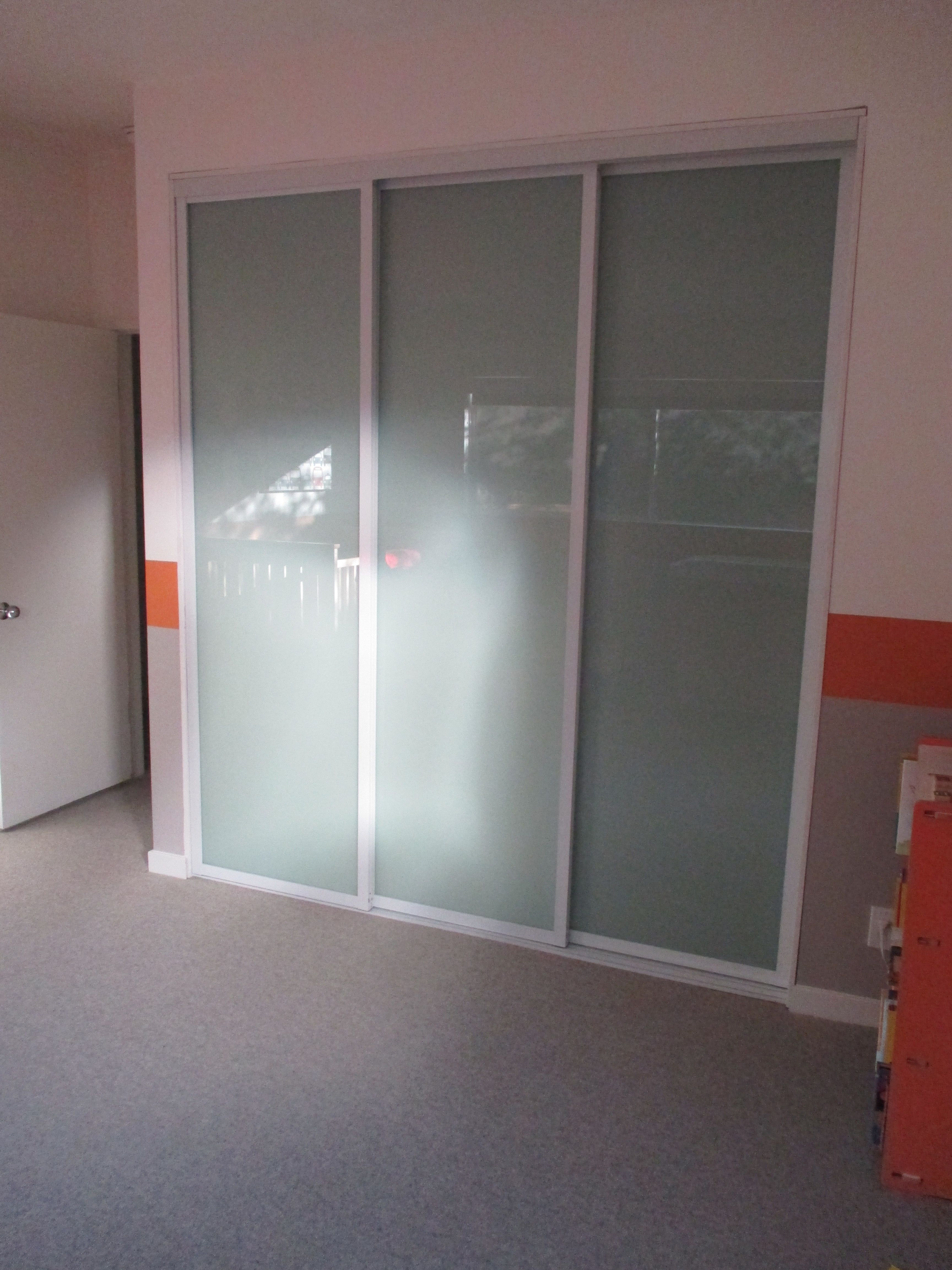 3 panel 3 track modern bypass closet door check out for Three panel sliding glass door