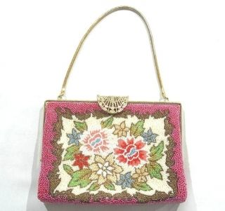 This is a beaded bag with flower design