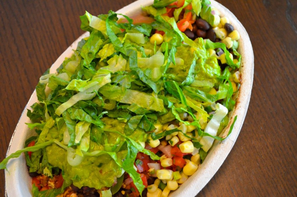 What to order from Chipotle when you're on the EAT TO LIVE Diet // MyMommaToldMe.com.  Burrito bowl with no rice, double black beans, sofritas (a new organic braised tofu item), fajita veggies, mild salsa (this pico de gallo has the least sodium), corn, guacamole and extra lettuce.