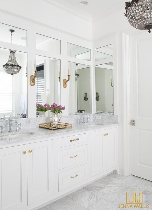White Bathroom With Gold Accents Boasts A White Dual