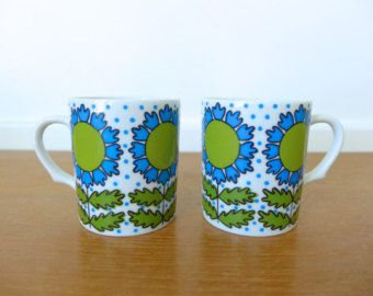 Two retro blue sunflower coffee mugs made in Japan