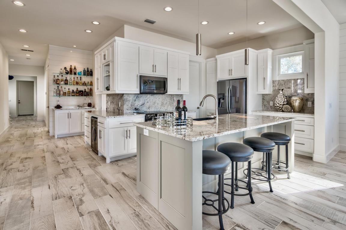8109 N Lagoon Drive Panama City Beach Fl 32408 Mls 791630 Scenic Sotheby S International Realty White Modern Kitchen Home Kitchens Kitchen Remodel