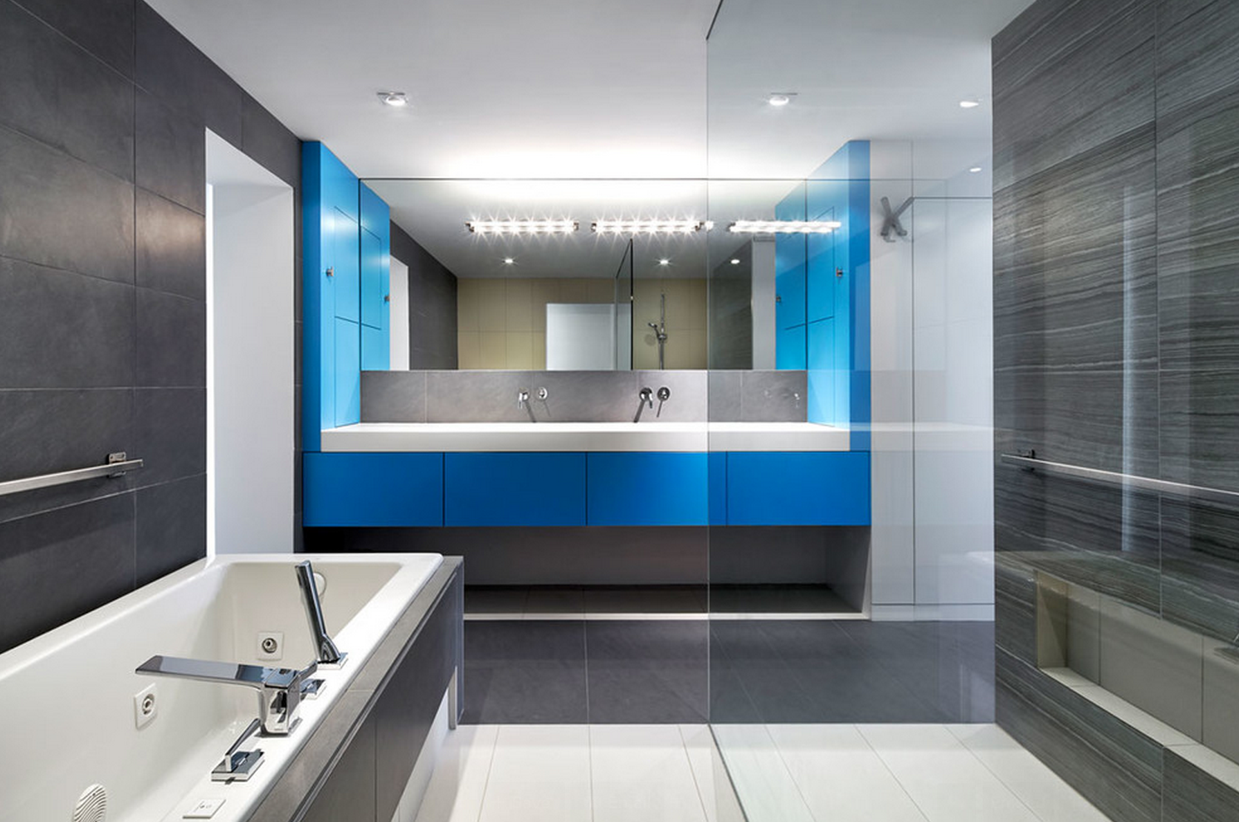 This Sleek Bathroom Opts For A Striking Pop Of Color And A Vanity Made Of Corian Bathroom Design Luxury Modern Luxury Bathroom Bathroom Design Gallery