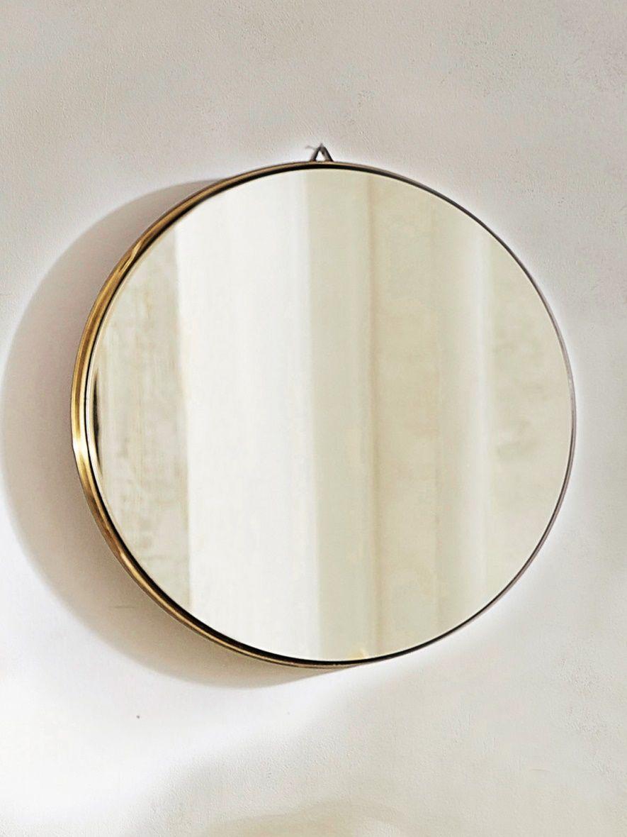 Noir  l extérieur doré  l intérieur ce grand miroir rond