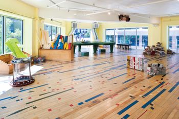 We love children s museum goes green with reclaimed wood for Reclaimed gym floor