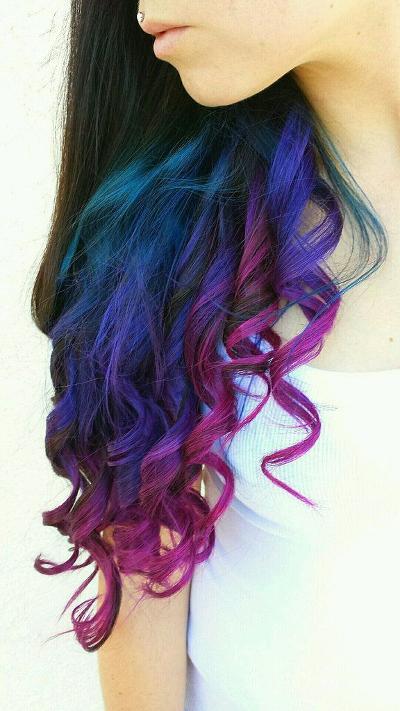 This colorful ombre hair color mixes purple, blue, and pink for ...