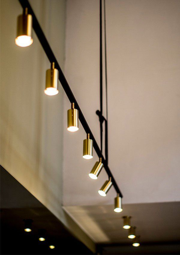 10 track lighting styles that prove anything can be chic pinterest chic brass track lights aloadofball Choice Image