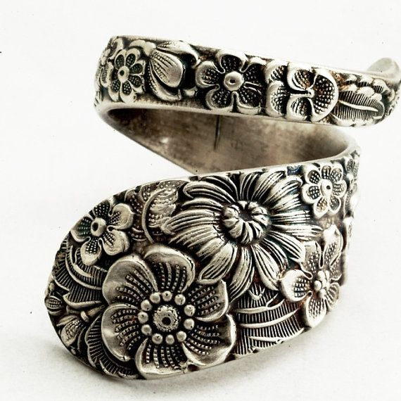 Vintage Victorian spoon ring in Floral bouquets embellish this spoon ring in high relief! This spoon pattern was originally made by Alvin Co in 1932 called,
