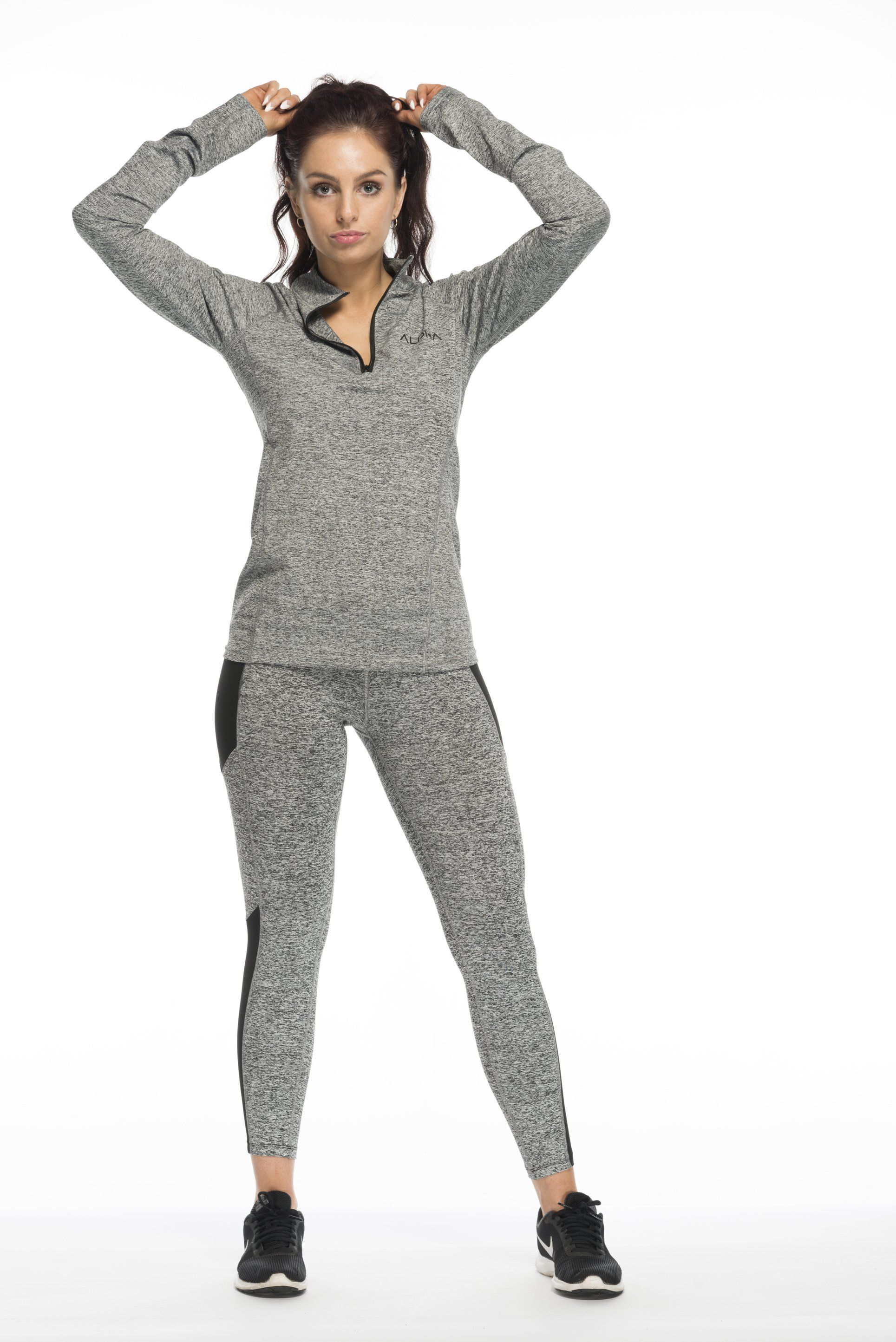 9b9ce8345 This all grey gym outfit is ideal for women who want to be stylish and  comfortable while they train. Team women s gym leggings with a workout  jumper for ...