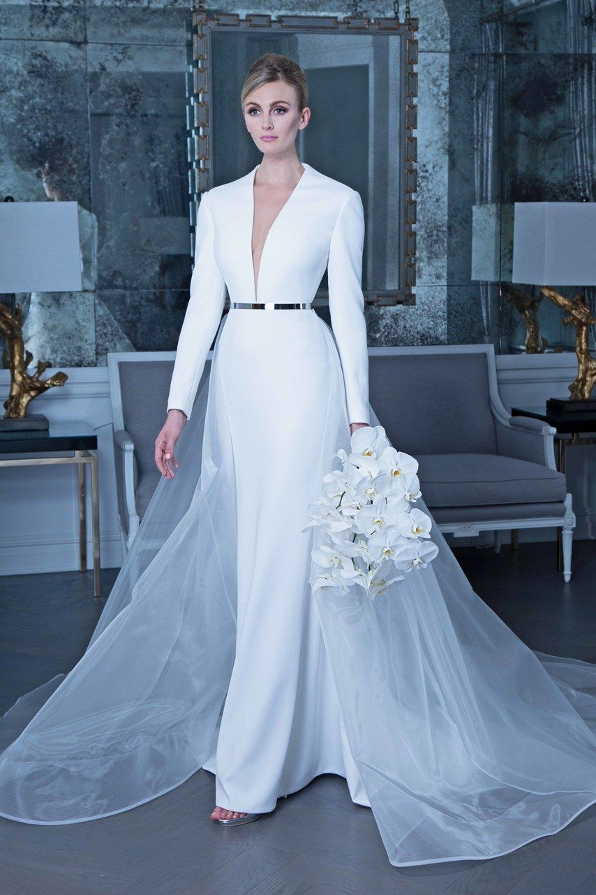 28abba99b4 This nontraditional wedding dress by Romona Keveža features the chic trend  of crepe fabric