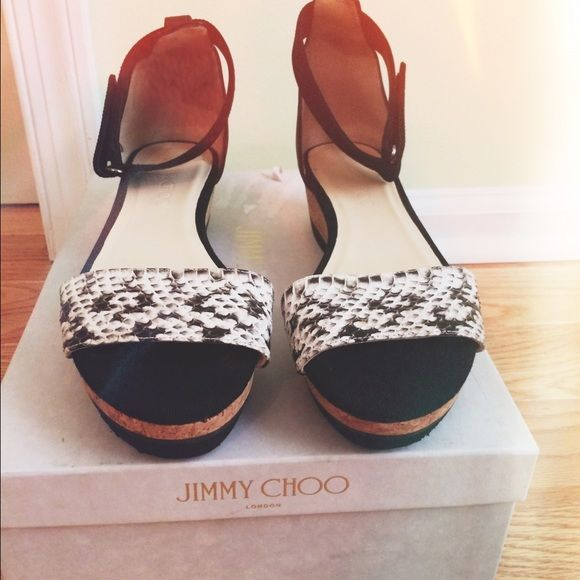 Jimmy Choo Neat Sandals Black and white snakeskin print sandals. Cork platform. Authentic jimmy Choo. Never worn before. Made in Spain. Very chic and stylish. No trades please. NWT Jimmy Choo Shoes Sandals