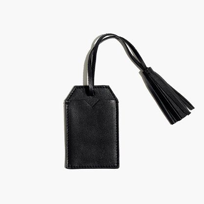 ff076c9566d9 A sleek leather luggage tag complete with a tassel. Upgrade whatever ...