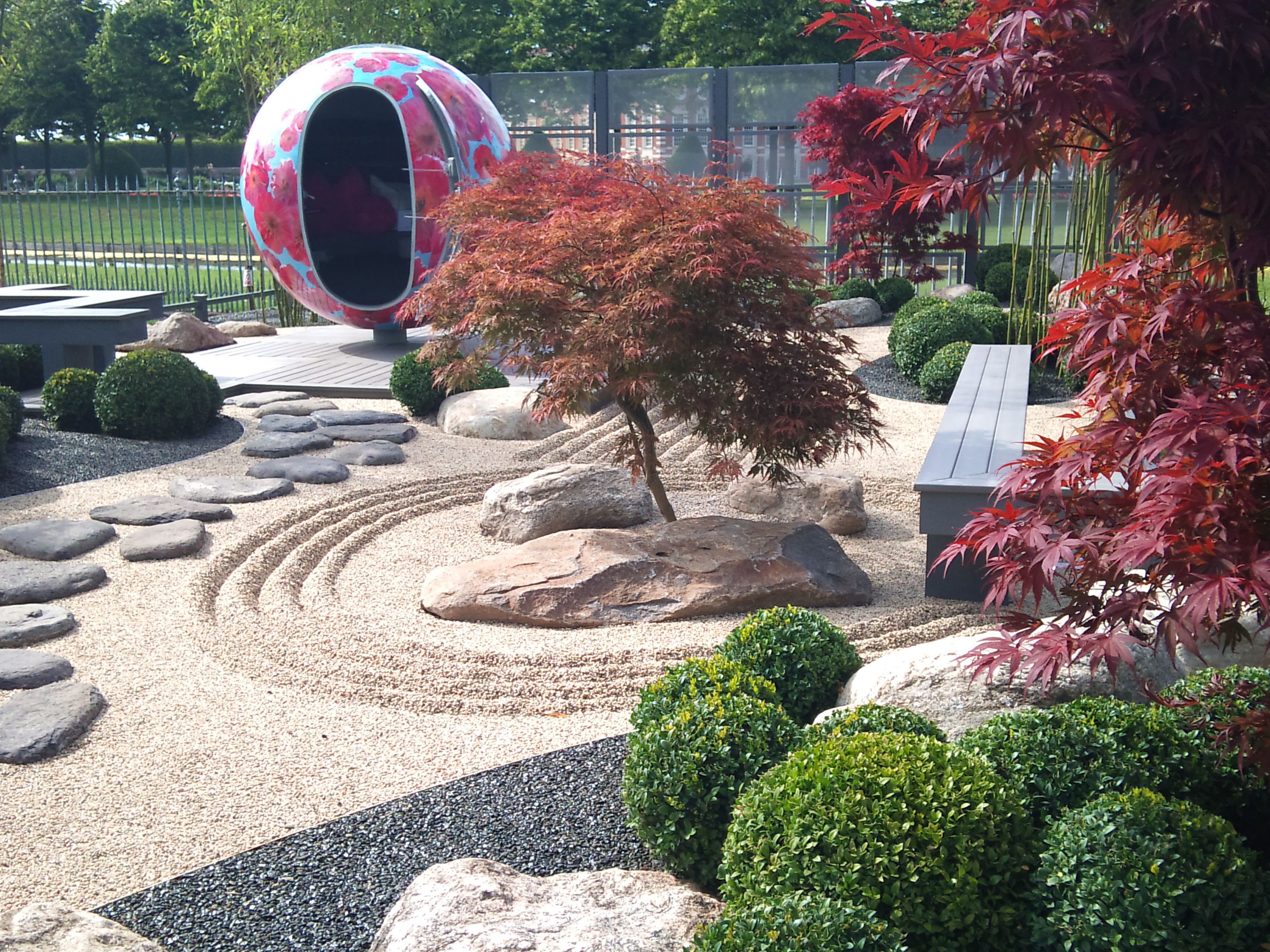 modern japanese garden ideas with stone footpath and seating
