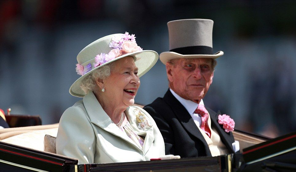 Will one be a winner? The Queen laughs out loud as she is driven up the Royal Ascot racecourse in a landau with the Duke of Edinburgh beside her 18 June 2014