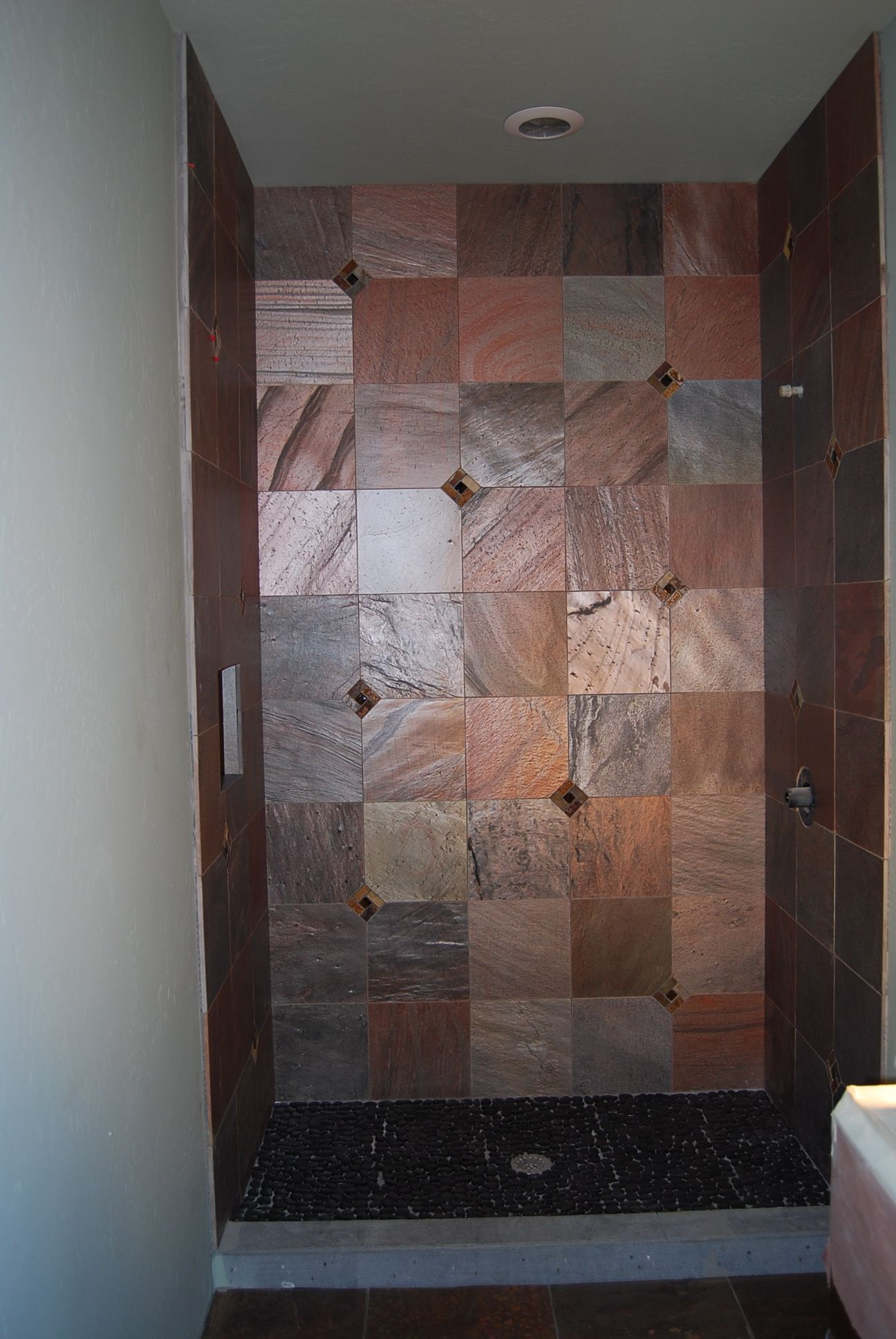 A Shower I Designed With Copper Quartzite Field Tile Slate Pinwheel Inserts Gl Centers In Clipped Corners And Black Pebble Floor