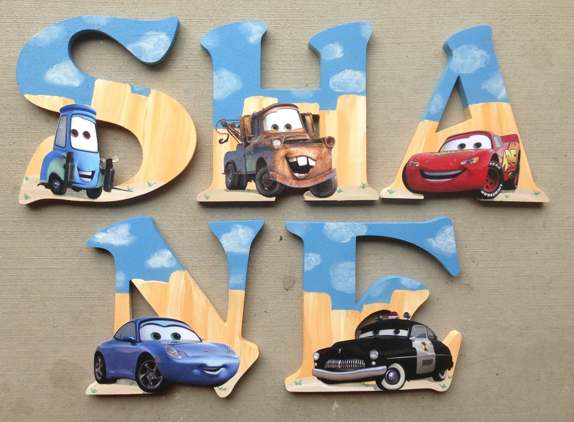 Custom Wooden Letters, hand-painted and designed by Kid Murals by Dana Railey. Letters are $10-$12 per letter plus S&H. They are great as #babyshower gifts, #nurserydécor, #kidsrooms, #woodendécor, teacher gifts, #hangingletters, and more!  Any theme, specific characters, pattern and color can be created!  Please contact Dana on FB at http://www.facebook.com/kidmuralsbydanarailey   #babynursery, #babyboy, #cars, #disneycars, #boys, #nurserydécor,  #pixarcars, #babydecor