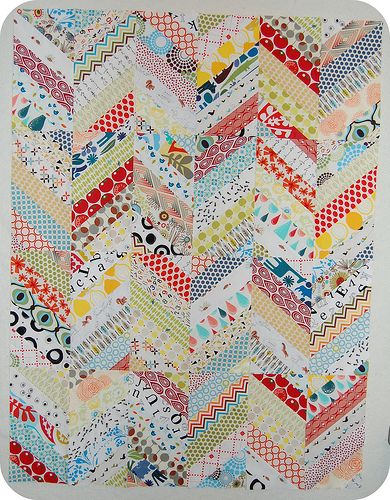 Love this!  You could make something really adorable with a couple of $2 bags of scrap fabric. Chevron scrappy quilt.