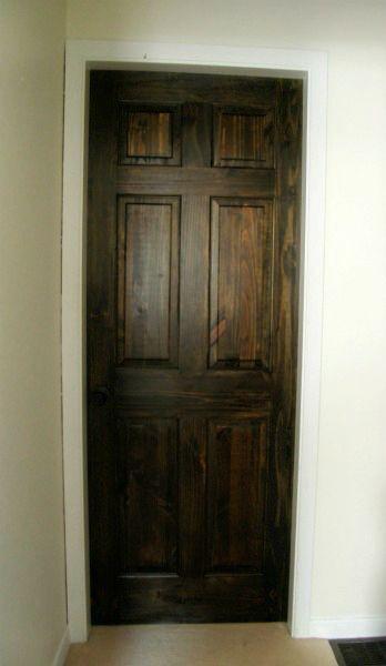 Dark doors elegant entryway with dark gray walls framing for Dark doors light walls