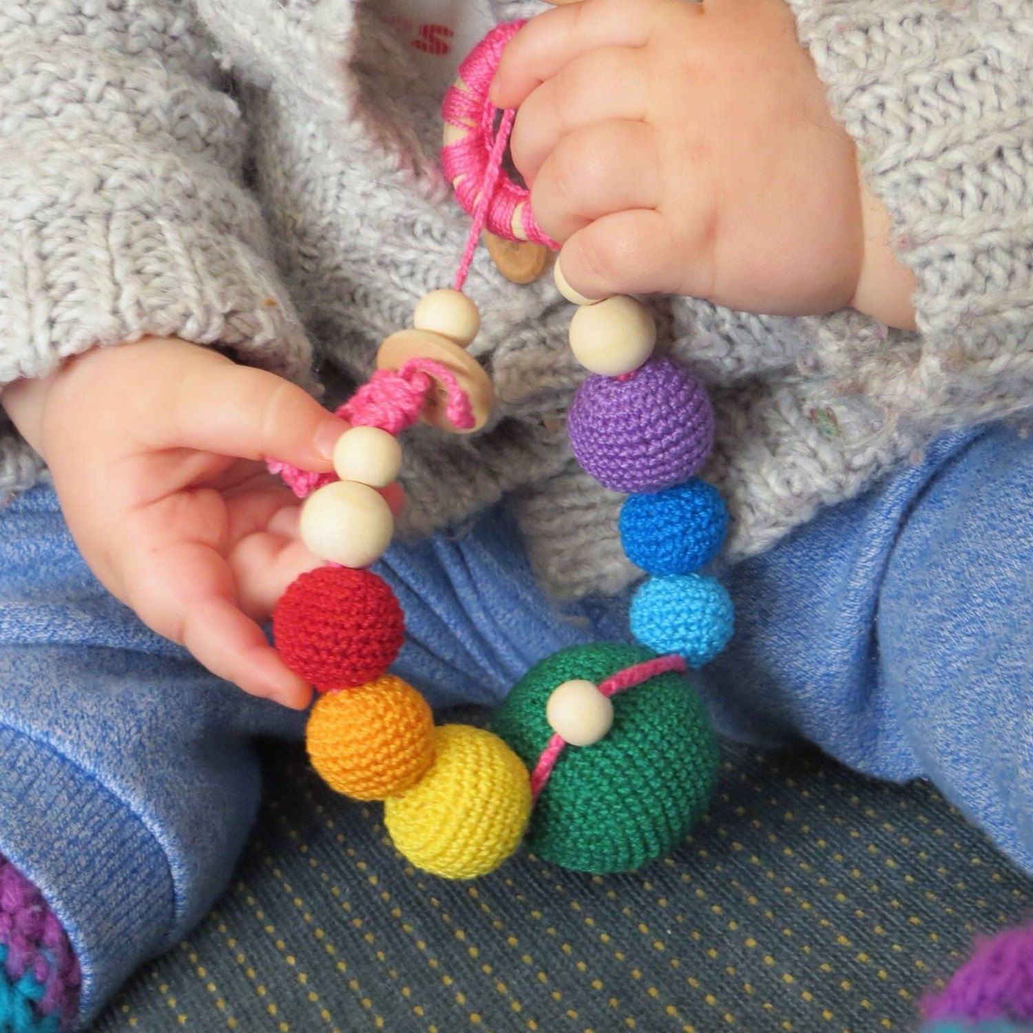 Baby Lina loves her teething toy!  100% natural, colorful and... it sounds! Perfect for your little ones!