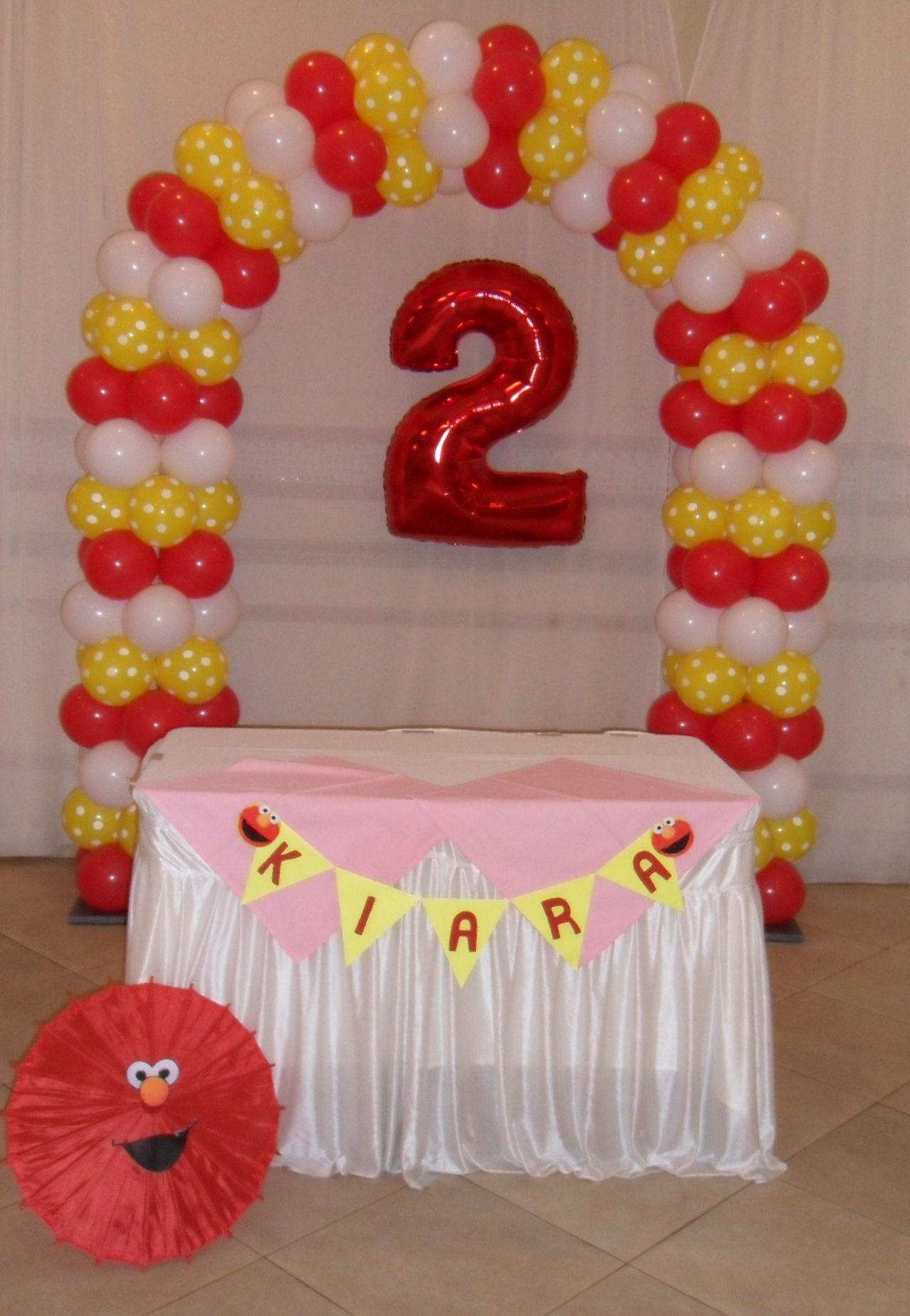 Elmo red yellow polka dot and white balloon arch for girl