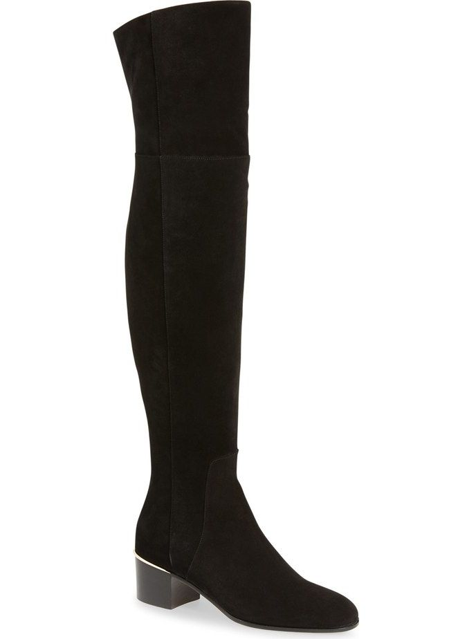 c4386473c63 A sleek over-the-knee boot grounded by a bold block heel epitomizes modern  drama and sophistication.