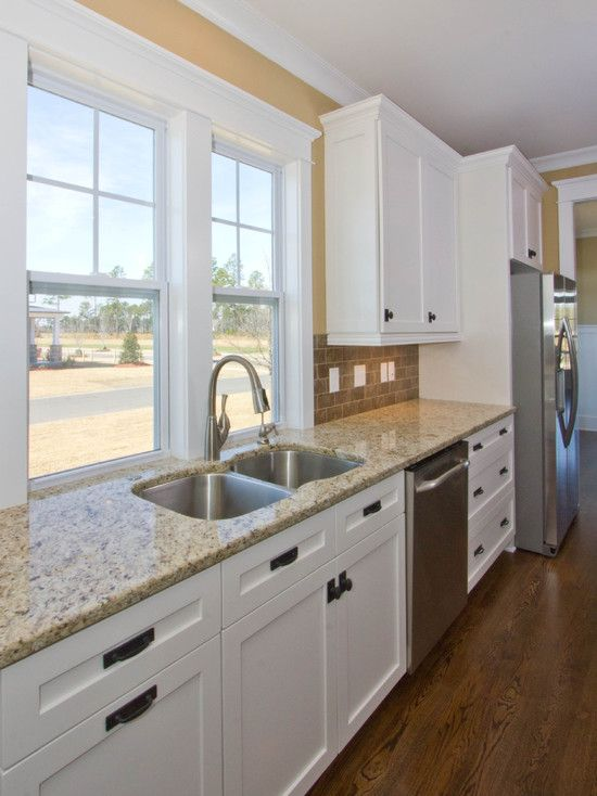 kitchen white cabinets with dark handles. Love the whole color ...