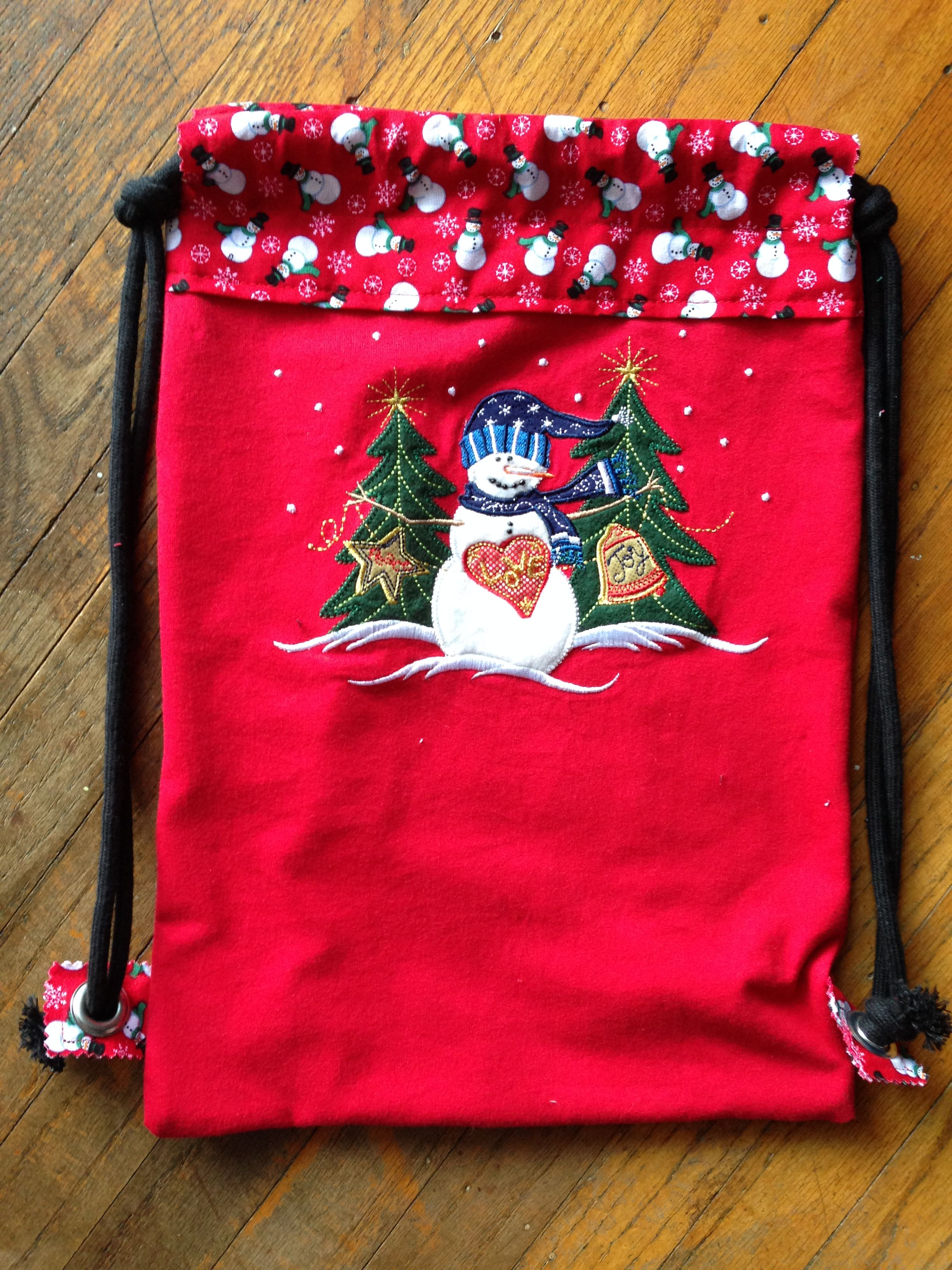 Red Snowman Backpack. This is my personal Christmas time bag. It was t shirt worthy of becoming a bag and looking better. It has beads inside the art work. soo cute.