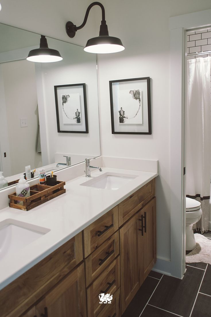 Modern style meets a rustic mood in a bathroom renovation that pairs