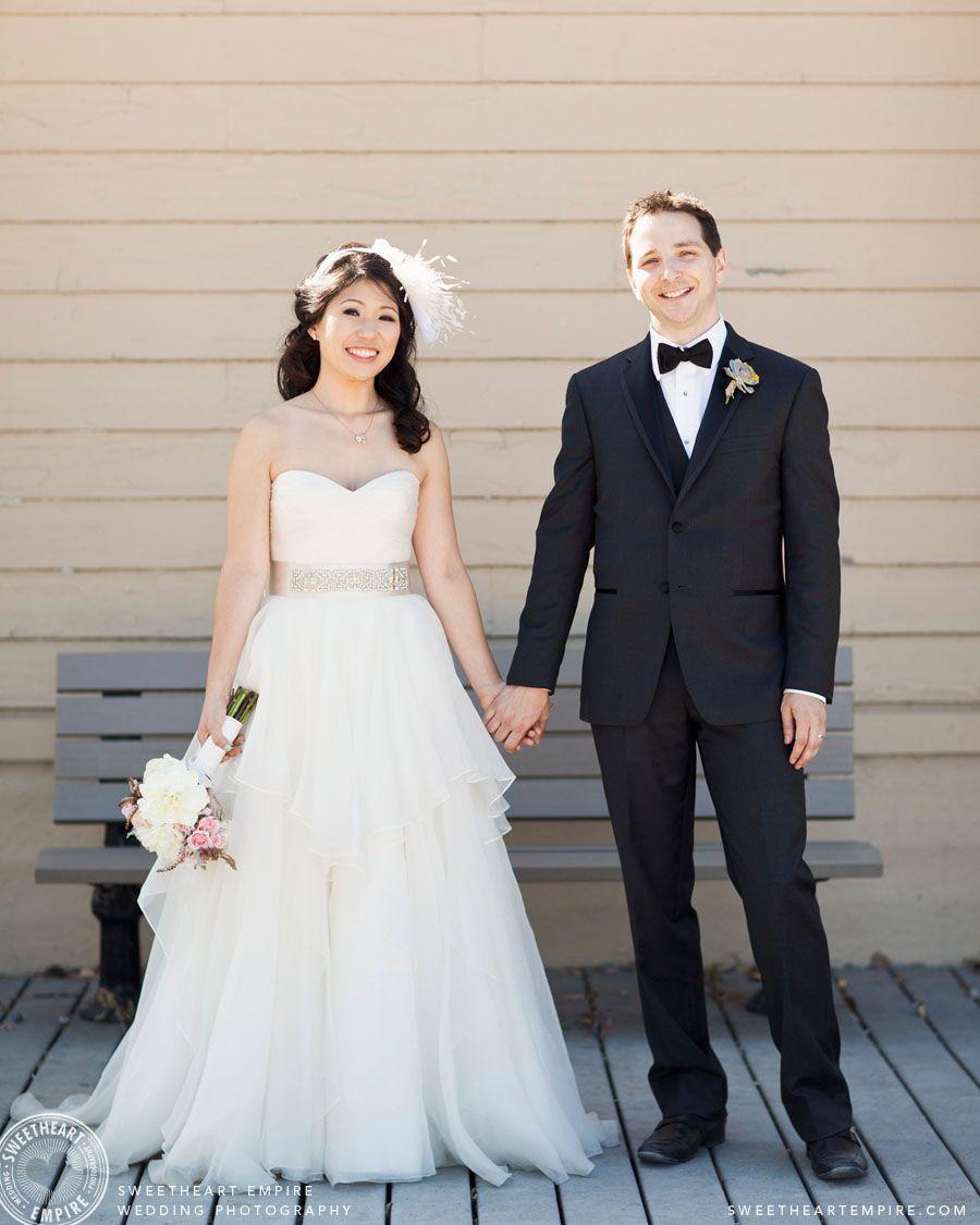 Wedding beach house  Newlyweds holding hands by the beach house Cherry Beach Wedding