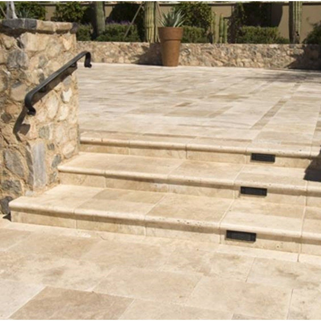 Light Travertine Outdoor Pavers Grouted In A Garden Travertine