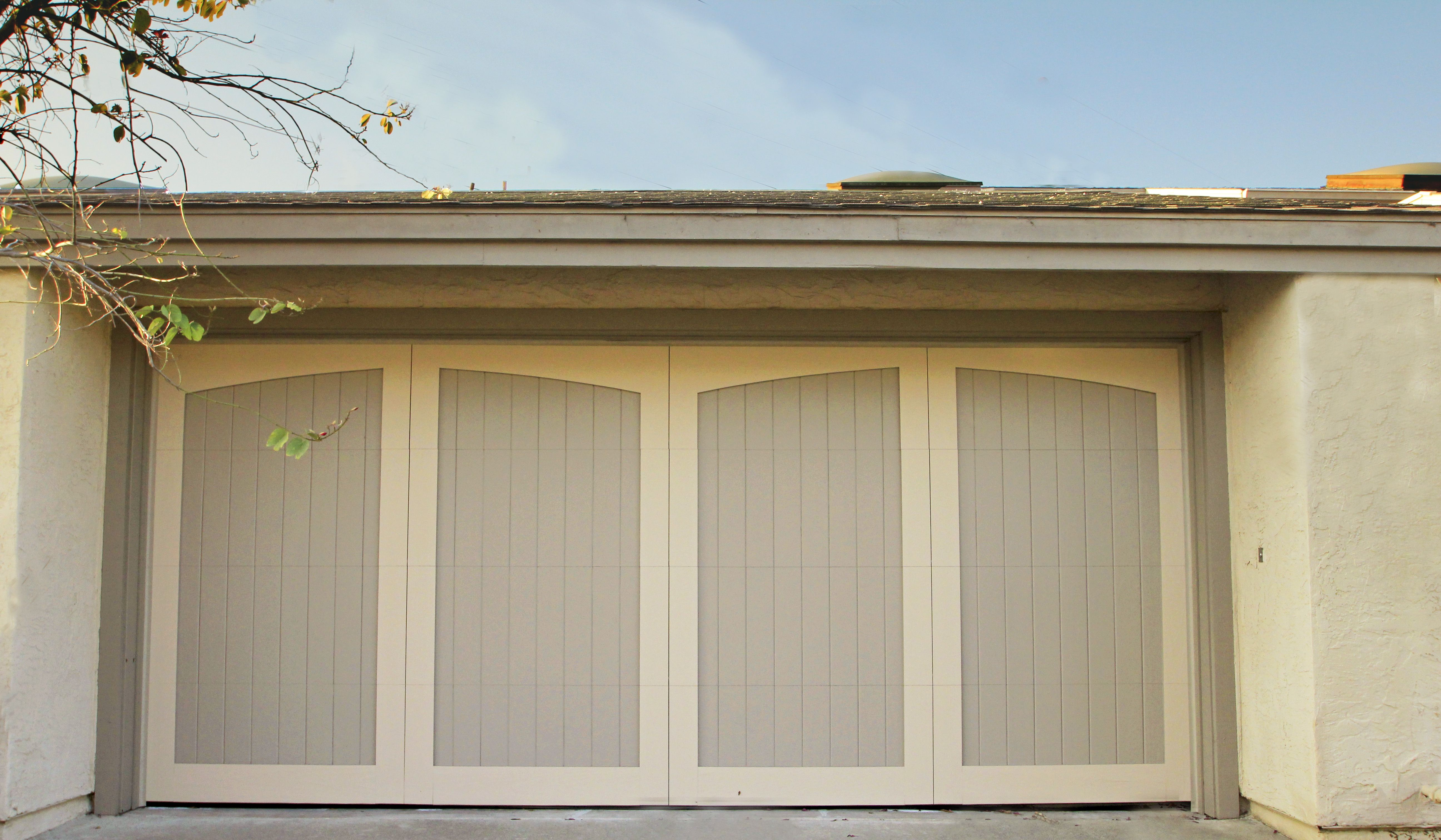 Bon Painted Wood Garage Door With Slightly Arched Top Panels.