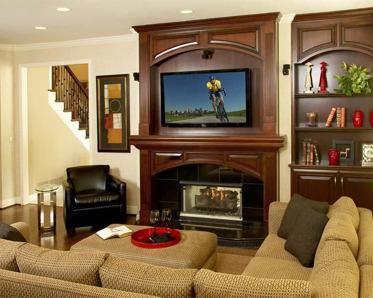 The fireplace was updated with new woodwork in a dark mahogany ...
