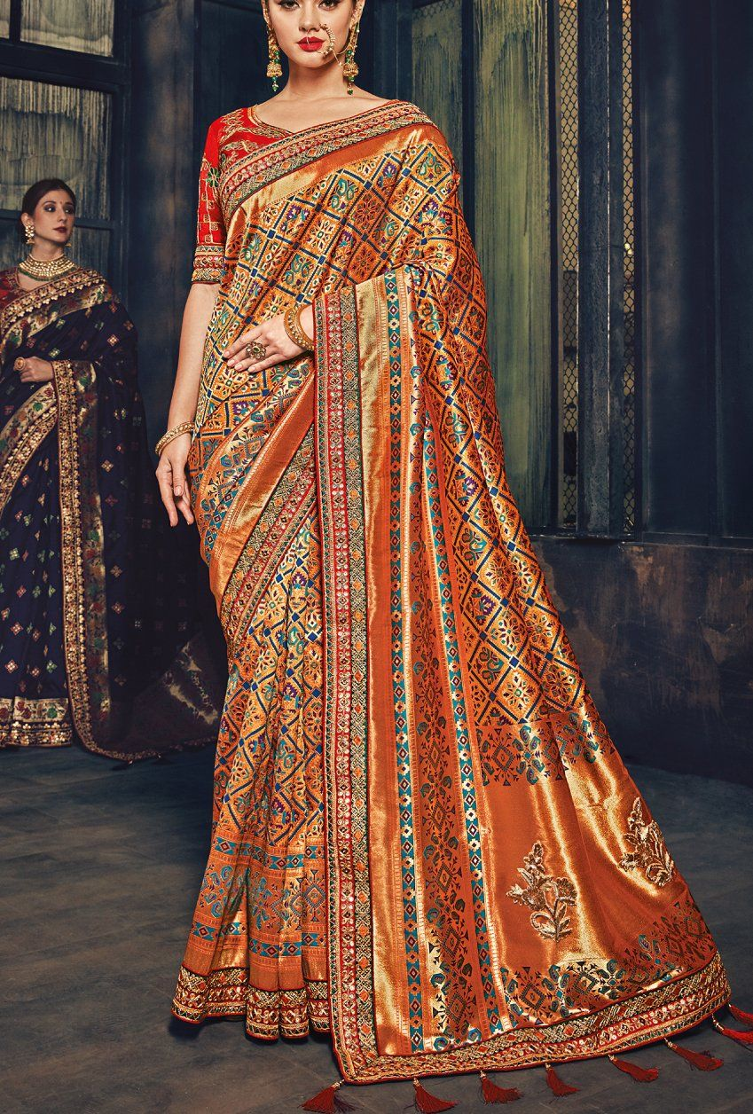 000d8e447fa76e Featuring red and bronze designer embroidered party wear saree. TOP   Banarsi Silk FABRIC  Banarsi silk COLOR  Red and bronze - The product will  be shipped ...