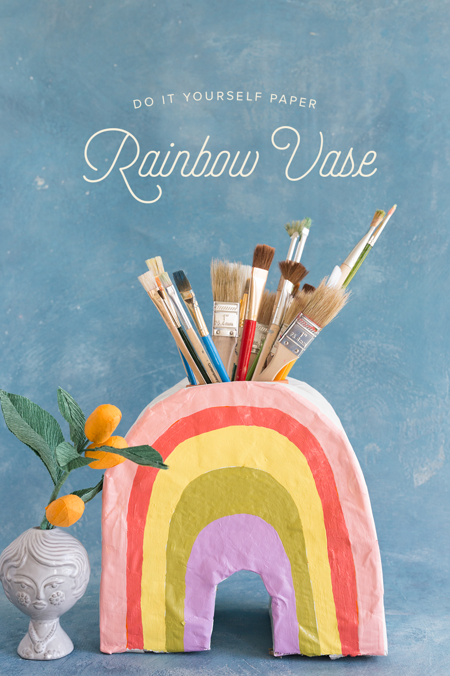 We're taking craft the rainbow to the next level! Organize your craft supplies and bring a bit of sanity to your workspace with a Paper Mâché Rainbow Vase.