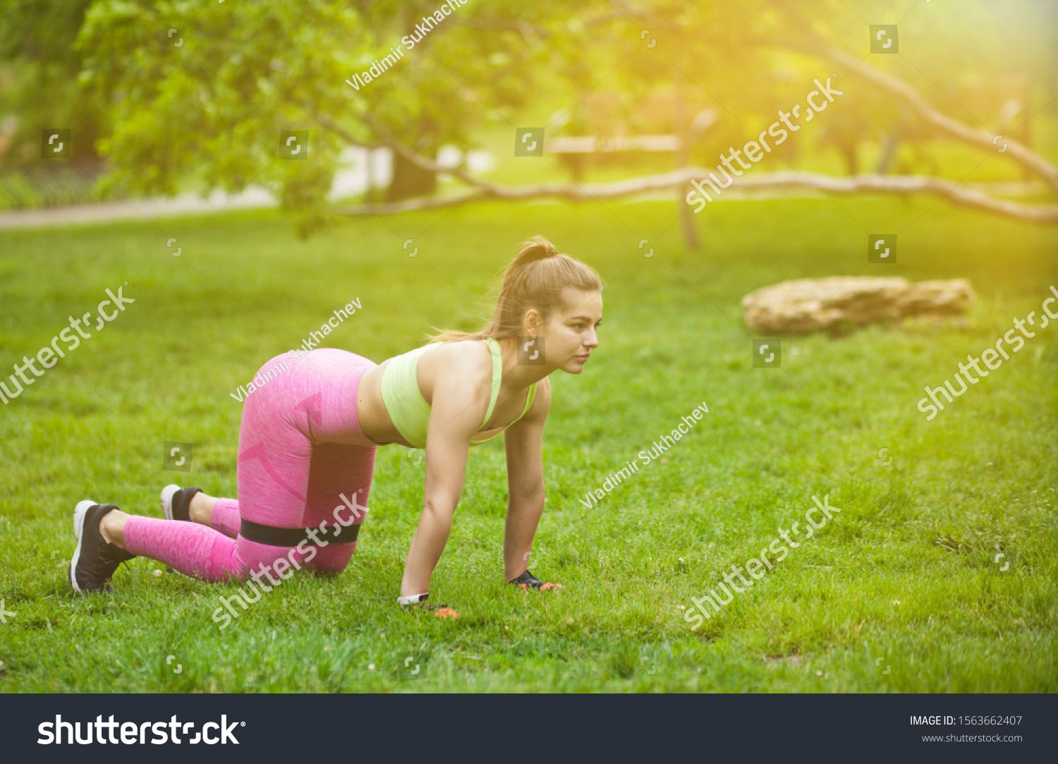Sporty woman doing exercises with fitness gum expander in the park outdoors #Sponsored , #AFFILIATE,...