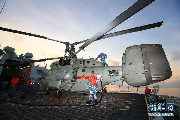 East China Navy Fleet conducts a training exercise in the South China Sea, in a bid to temper the combat capbility of the troops in complex environment. Kamov Ka-28 ASW version?(Source: Xinhua)