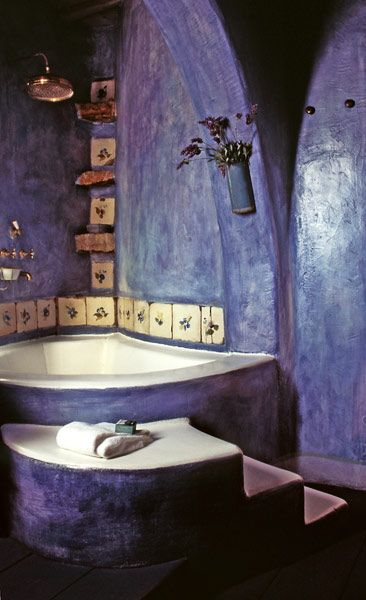 Not too crazy about the purple, but like the idea of the sunken tub, rustic tile, and the atypical shape.